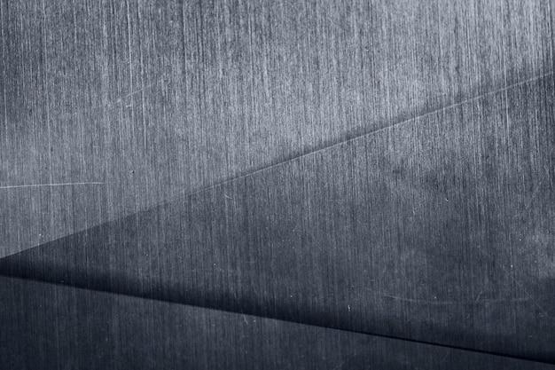 Dunkler silberner metallischer gemusterter hintergrund mit dreiecken