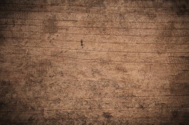 Dunkler strukturierter hölzerner hintergrund des alten schmutzes, die oberfläche der alten braunen holzbeschaffenheit, draufsicht braune holztäfelung