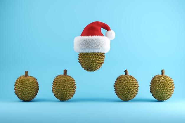 Durian mit weihnachtsmütze schwimmt auf blau