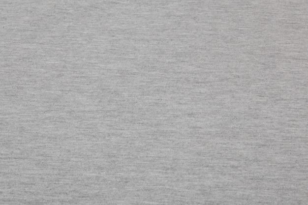 Echte grau melierte strickware aus strukturiertem hintergrund aus synthetischen fasern.