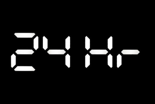 Echte weiße led-digitaluhr auf schwarzem hintergrund, die 24 stunden anzeigt