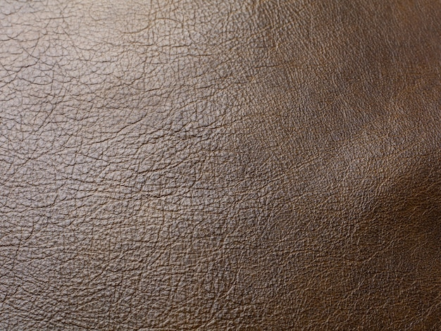 Echtes braunes rinderleder textur hintergrund. makrofoto