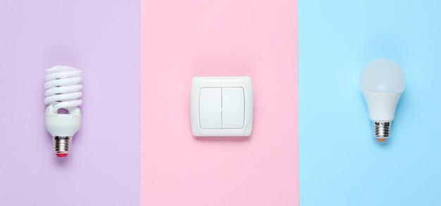 Economy glühbirnen, der schalter. draufsicht. minimalismus elektro-consumer-konzept