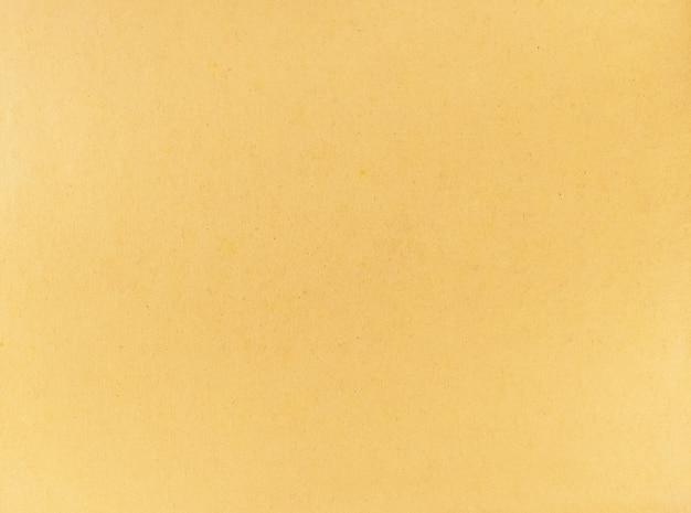 Ein alter gelber papierschmutzbeschaffenheitshintergrund