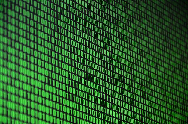 Ein bild eines binären codes, der aus einem satz grünen ziffern auf einem schwarzen hintergrund besteht