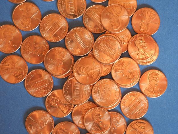 Ein-cent-dollar-münzen, vereinigte staaten über blau