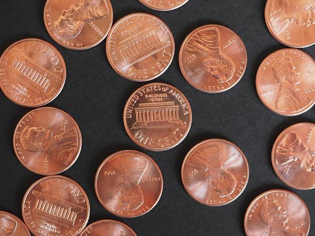Ein-cent-dollar-münzen, vereinigte staaten über schwarz