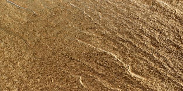 Ein goldener stein mit textur als hintergrund.