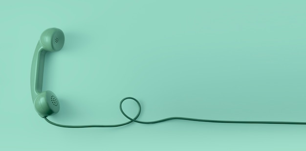 Ein grüner weinlesetelefon-telefonhörer mit grünem hintergrund.