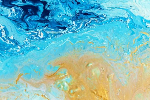 Ein handgefertigter acrylhintergrund in blauen und weißen farben. abstrakte bunte textur, tapete, hintergrund für design und kreativität. mischen von farben, moderne kunst. flüssige kunst.