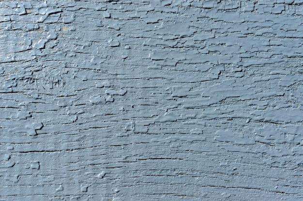 Ein hölzerner gemalter grauer hintergrund. gealterte textur. jahrgang. rustikaler stil.