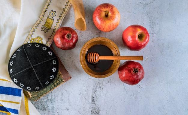 Ein jüdisches neues jahr mit honig für den apfel- und granatapfelurlaub von rosh ha shana