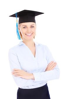 Ein junger glücklicher student posiert auf weißem hintergrund
