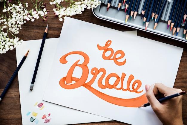 Ein künstler, der handbeschriftungsgrafik schafft