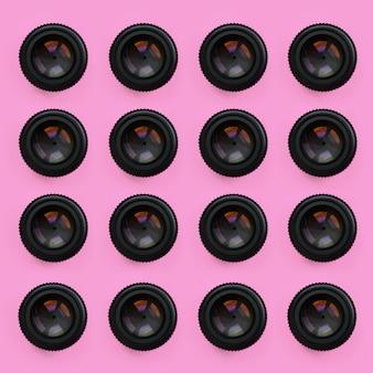 Ein paar kameraobjektive mit geschlossener blende liegen auf rosa textur