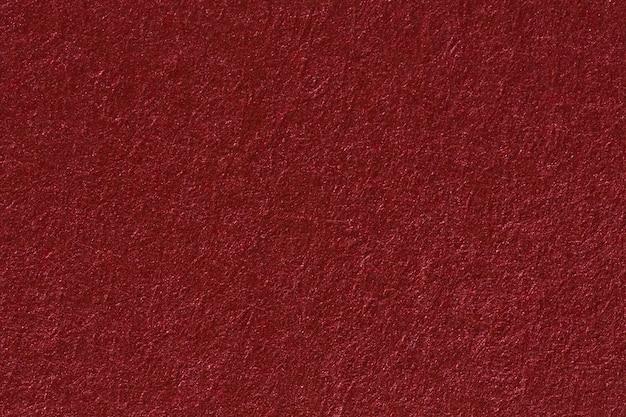 Ein roter hintergrund der weinlese mit einem kreuz und quer verlaufenden maschenmuster und schmutzflecken. hochauflösendes papier.