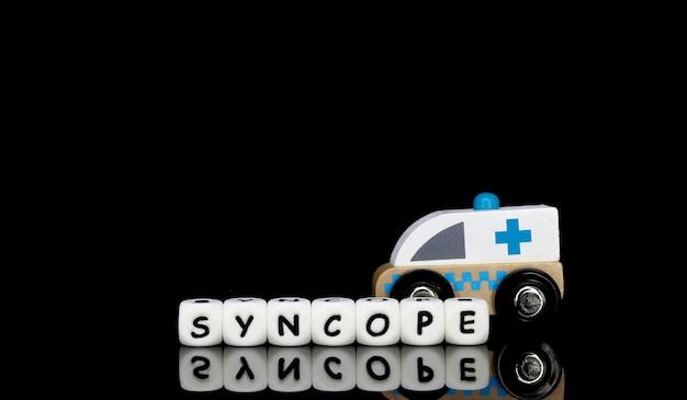 Ein spielzeugkrankenwagen und eine wortsynkope