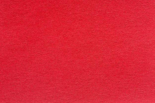 Ein strukturierter roter hintergrund mit einem dezenten rastermuster. hochwertige textur in extrem hoher auflösung