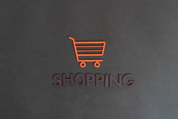 Ein warenkorb-icon-konzept ausgeschnitten briefe verkauf shop geschäft einfach minimalistisch