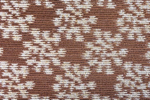 Ein wollteppich mit einem geometrischen muster von beige farbe nahaufnahme eines gewebten produkts