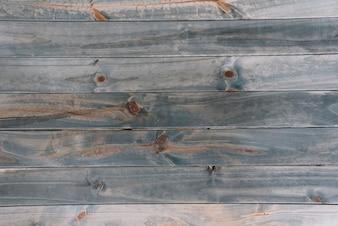 Eine alte grau farbige strukturierte hölzerne Planke