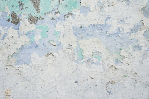 Eine alte und verwitterte gemalte wandbeschaffenheit passend für kunstwerkhintergrund