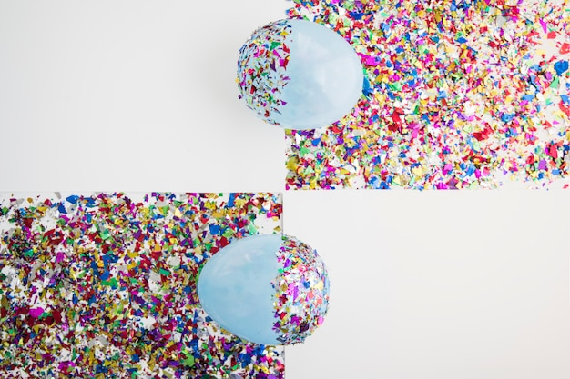 Eine draufsicht des ballons über den bunten konfetti gegen weißen hintergrund