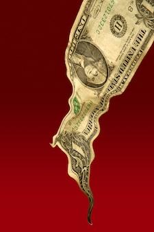 Eine flüssige fallende dollarnote, finanzkrisenmetapher