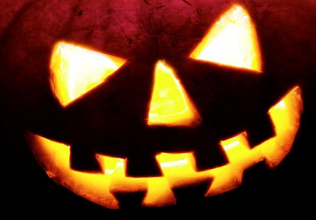 Eine furchtsame alte steckfassung-olaterne, halloween-dekorationshintergrund