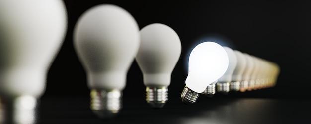 Eine glühbirne, die von anderen glühbirnen leuchtet, für herausragende, unterschiedliche kreative denkideen und innovationskonzepte durch 3d-rendering.