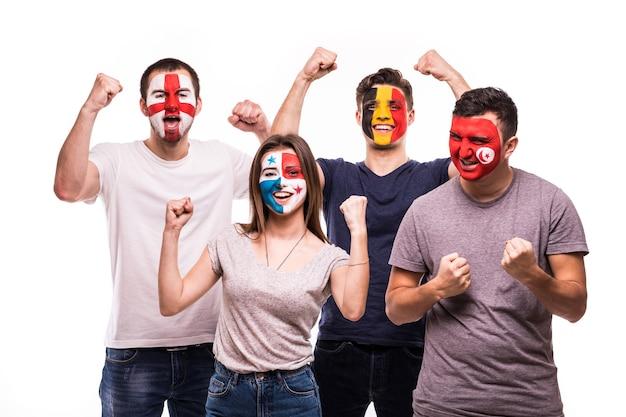 Eine gruppe von fans unterstützt ihre nationalmannschaften mit bemalten gesichtern. england, belgien, tunesien, panama fans siegesschrei lokalisiert auf weißem hintergrund