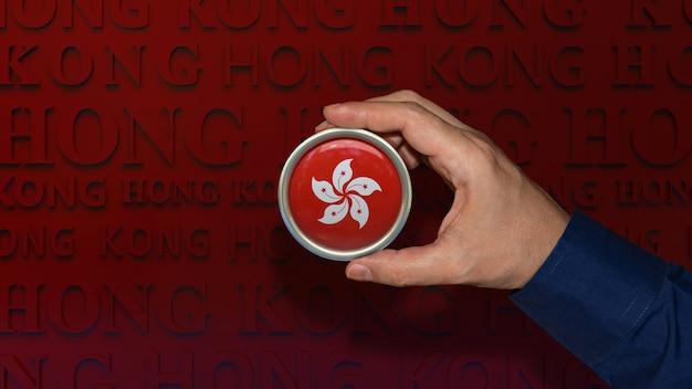 Eine hand, die ein abzeichen der nationalflagge von hongkong auf dunkelrotem hintergrund hält