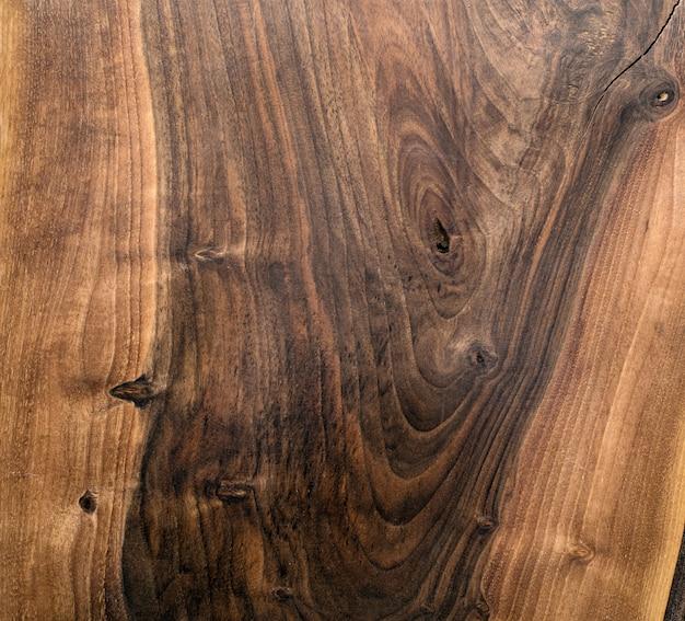 Eine hochauflösende textur des schreibtischs aus braunem eichenholz
