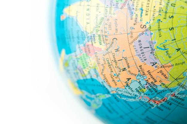 Eine kugel mit karte von china-hintergrund