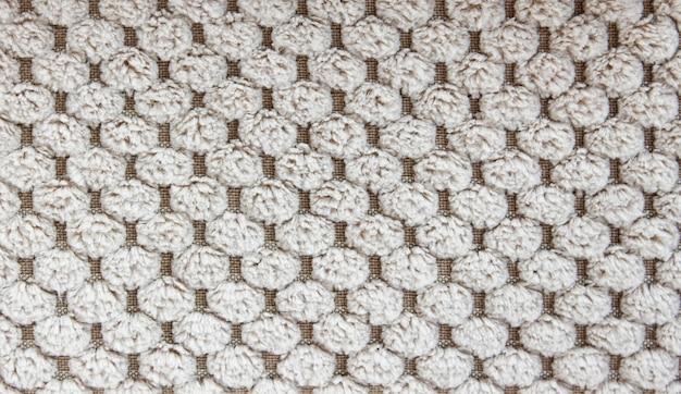 Eine leinwand aus flauschigem grauem stoff. ansicht von oben, stoffbeschaffenheit.