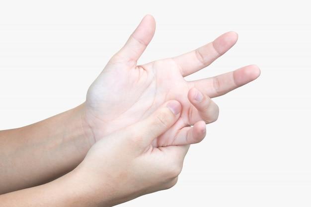 Eine nahaufnahme einer asiatischen hand mit einem wunden handgelenk und einer schmerzhaften handmassage.