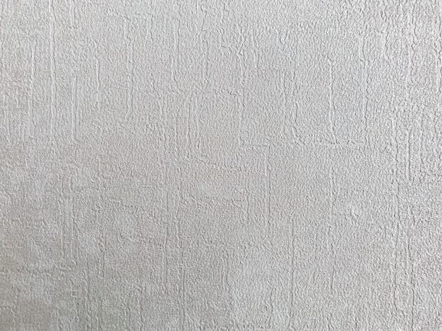 Eine raue textur des stoffes auf dem hintergrund des grauen papiers wird für das tapetendesign verwendet