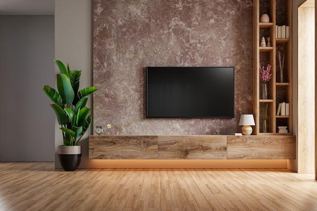 Eine tv-wand, die in einem dunklen raum mit dunkler marmorwand montiert ist. 3d-rendering