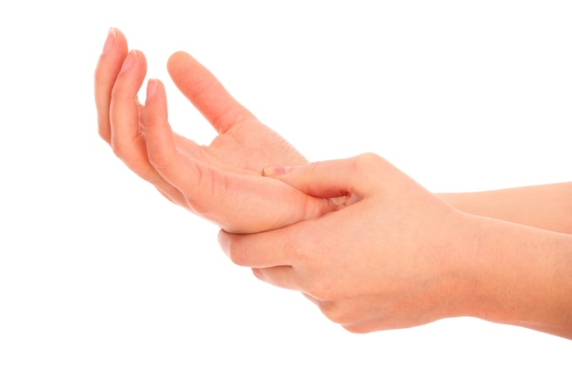 Eine weibliche handfläche über weiß