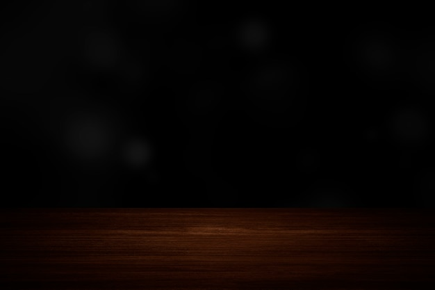 Einfache dunkelschwarze wand mit holzboden-produkthintergrund