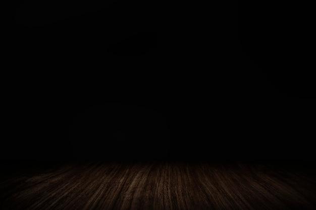 Einfache dunkelschwarze wand mit holzbrett-produkthintergrund