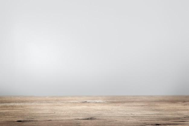 Einfache graue wand mit holzboden-produkthintergrund