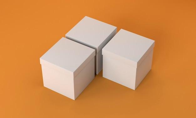 Einfache pappkartons auf orangefarbenem hintergrund