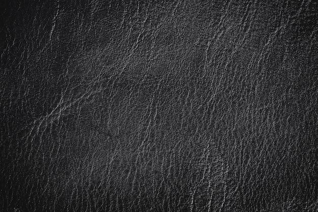 Einfacher schwarzer lederner beschaffenheits-hintergrund mit dem steigungslicht benutzt als klassischer luxuxhintergrund