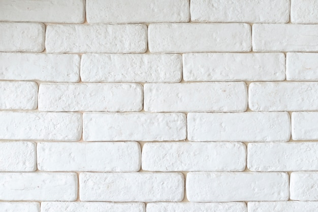 Einfacher weißer backsteinmauerhintergrund