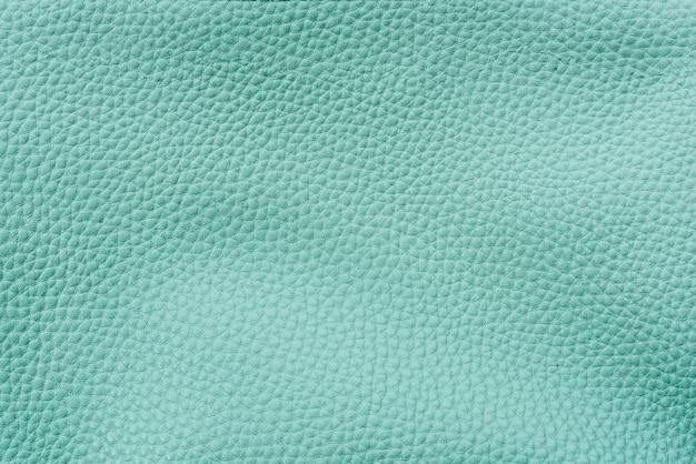 Einfarbiger, blaugrüner, strukturierter hintergrund aus leder