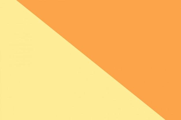 Einfarbiger gelber und orange hintergrund mit zwei tönen.