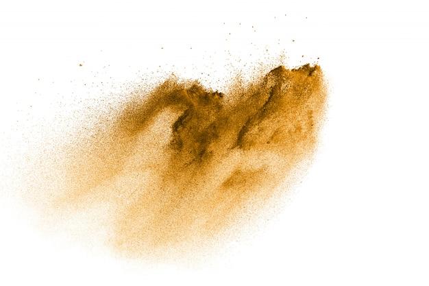 Einfrieren der braunen staubexplosion. die bewegung von braunem pulver wird gestoppt.