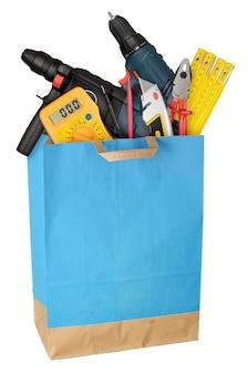 Einkaufstasche mit arbeitswerkzeugen isoliert