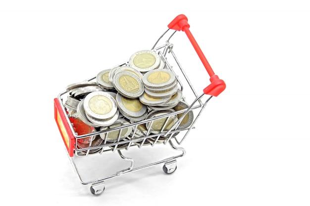Einkaufswagen mit vollen münzen
